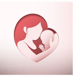 Mother holding baby in heart shaped silhouette vector