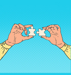 Pop art female hands holding two puzzle pieces vector