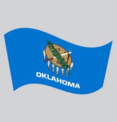 flag of oklahoma waving on gray background vector image vector image