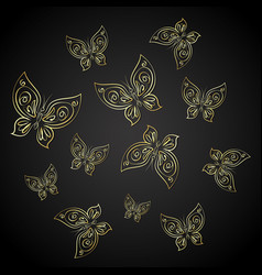 gold butterflies on a black background vector image