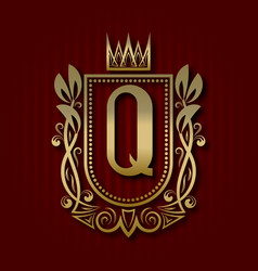 Golden royal coat of arms with q monogram vector