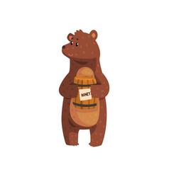 Cartoon bear standing with little wooden honey vector