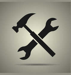 Hammer and spanner tools icon vector