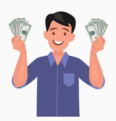 joyful man with banknotes money in his hands vector image