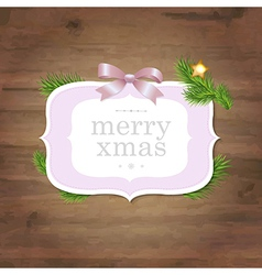 Christmas Label With Pink Ribbon And Wooden vector image