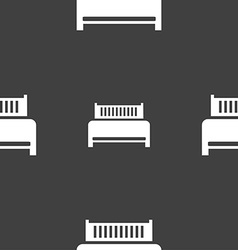 Hotel bed icon sign Seamless pattern on a gray vector image
