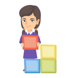 little caucasian girl playing with clourful cubes vector image