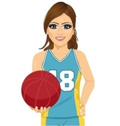 Female basketball player holding ball vector