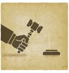 Hand with auction hammer or judge gavel vector