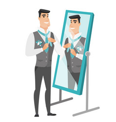 groom looking in the mirror and adjusting tie vector image