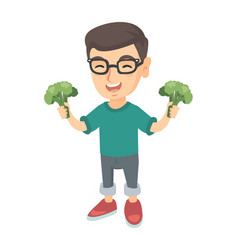 little caucasian boy laughing and holding broccoli vector image