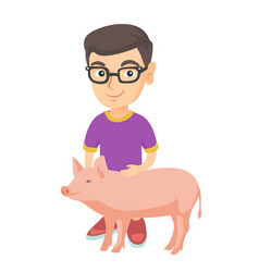 caucasian farmer boy in glasses stroking a pig vector image