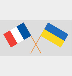 crossed flags ukraine and france vector image