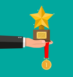 trophy winner gold star cup and medal vector image