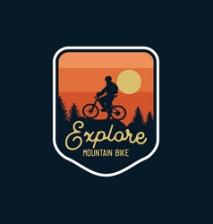 Explore mountain bike badge silhouette sunset vector