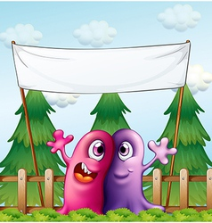 Two loving monsters under the empty banner vector