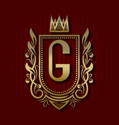 Golden royal coat of arms with g monogram vector