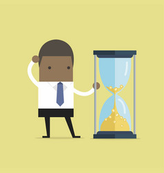 businessman is looking at hourglass with gold coin vector image