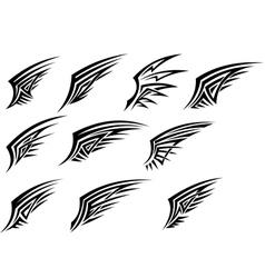 Set of black tribal wing tattoos vector image