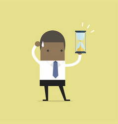 african businessman holding sandglass or hourglass vector image vector image