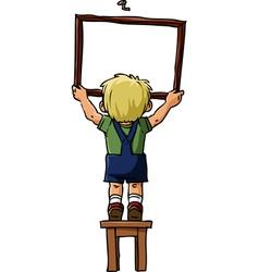 boy hangs a picture vector image vector image