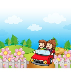 A red car with a young girl and boy vector image vector image