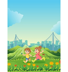 Two adorable kids playing with the butterflies vector image