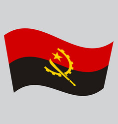 flag of angola waving on gray background vector image vector image