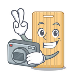 Photographer wooden cutting board mascot cartoon vector