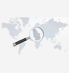 serbia on magnifying glass in world map vector image