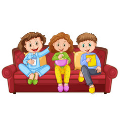 Three happy kids eating snacks on sofa vector
