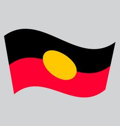 australian aboriginal flag waving gray background vector image vector image