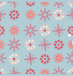 red and ivory snowflakes on blue background vector image
