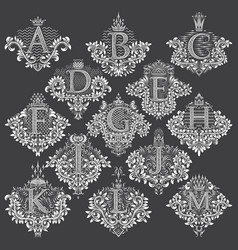 Set heraldic monograms in coats arms form vector
