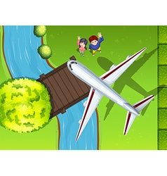 Aerial view of airplane flying over the park vector image