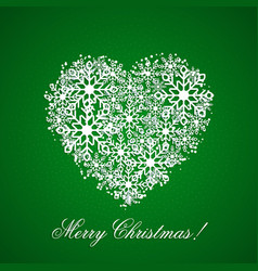 green background with a heart from snowflakes vector image