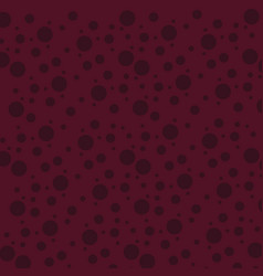 Seamless maroon circles spots in different sizes vector