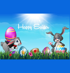 two easter bunnies with decorated easter eggs in a vector image
