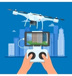 Drone with remote control flying over city Aerial vector image