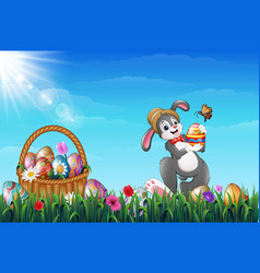easter bunny holding easter eggs with a butterfly vector image