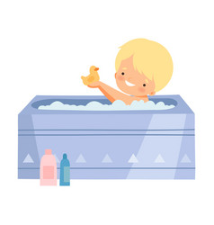 Little boy taking bath and playing with yellow vector