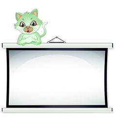 A green cat above the whiteboard vector image vector image