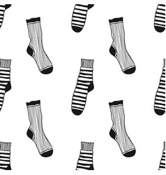 Seamless black white pattern of doddle socks for vector