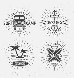 Surfing vintage black labels with rays vector
