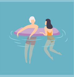 Young couple floating on air mattress young man vector