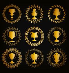 golden shields with laurel wreaths cups vector image