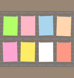 eight multicolored paper on brick wall vector image