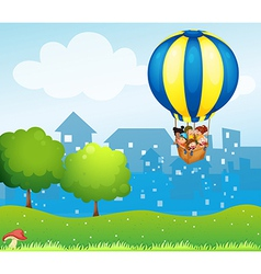 A big hot air balloon with kids vector image vector image