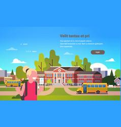 Girl raising hands yellow bus school building vector