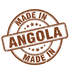 made in angola brown grunge round stamp vector image